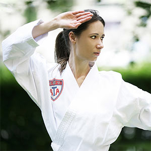 Woman outdoors doing Martial Arts Block