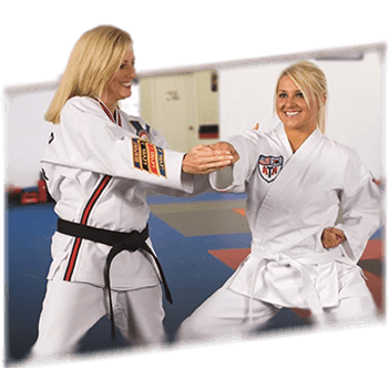 Mom punching in ATA Taekwondo class with Female Instructor