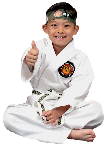 Small Tiny Tiger Kid sitting on the ground with a smile and a thumbs up